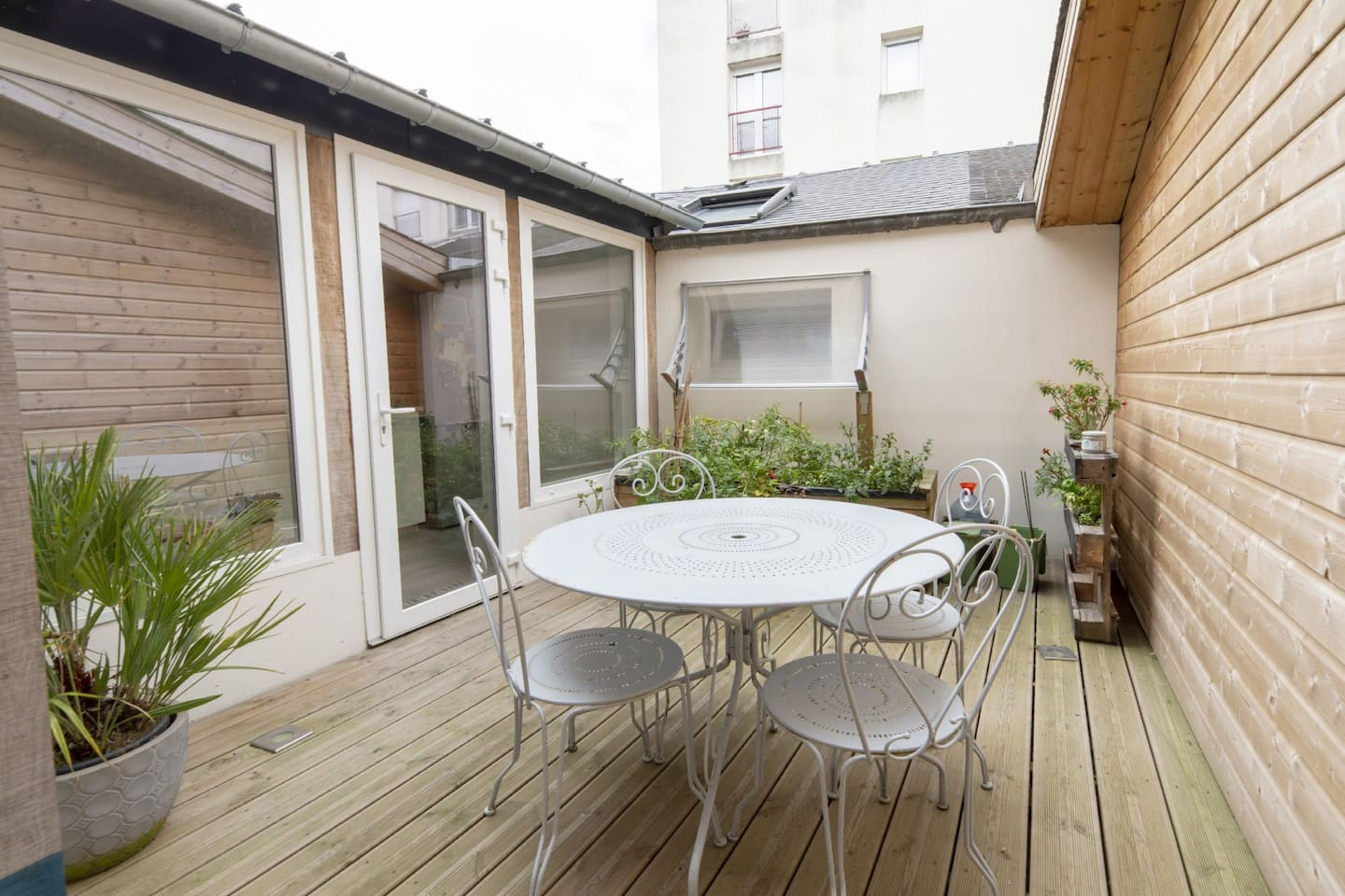 Really charming patio with garden table and chairs.