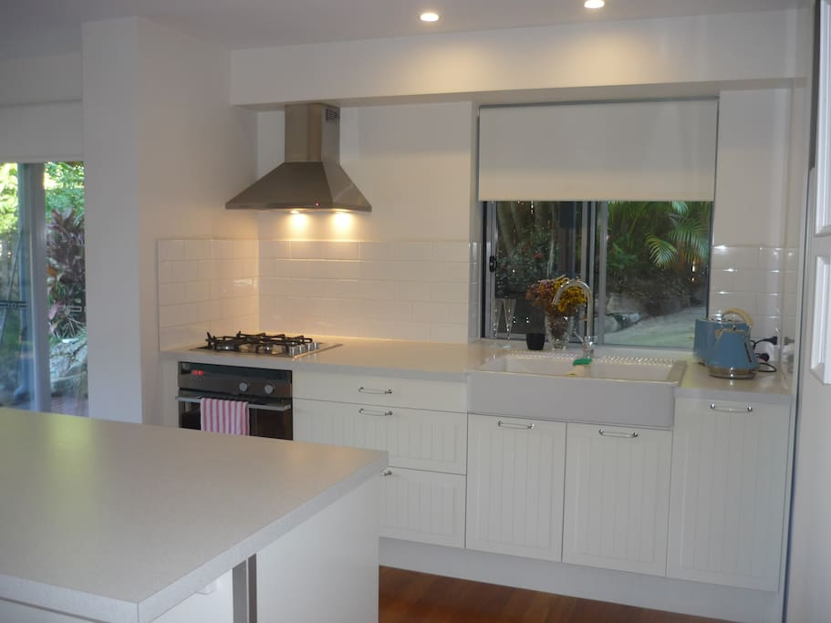 Fully self contained kitchen with breakfast bar.