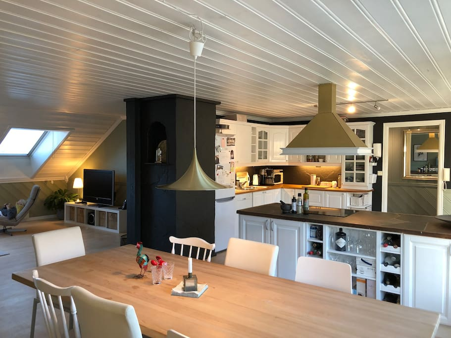 Kitchen with dining table seating 8. Open space with living room