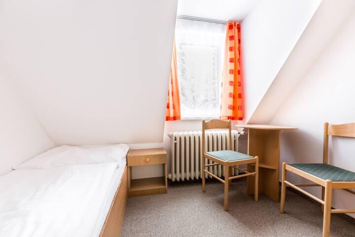 Podkrovní dvojpokojové rodinné apartmá