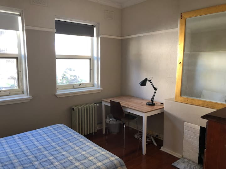 Spacious room for two near train and shops