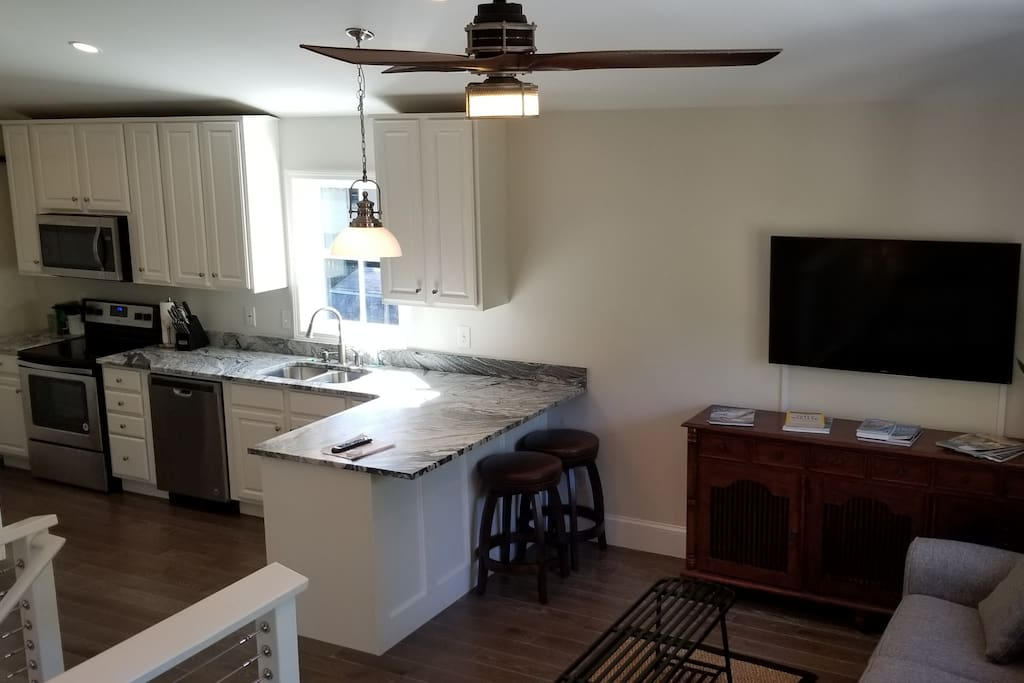 Daytime view of the living room / kitchen. TV cables now hidden.