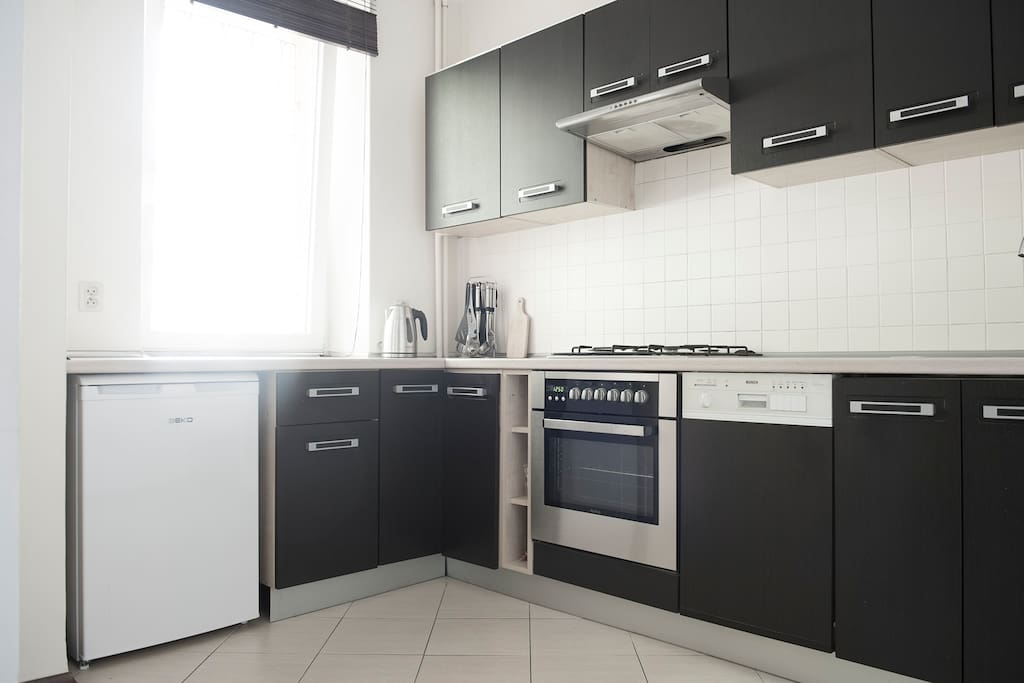 A kitchen with all cooking utensils
