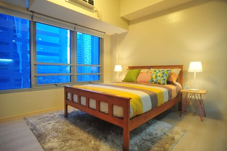 Cozy 22nd floor Condo unit at Eastwood City. - 奎松城 - 公寓