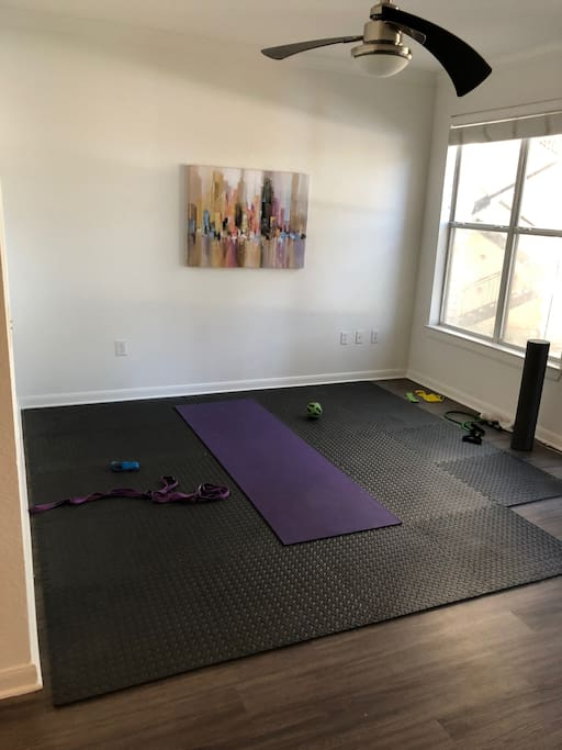 The apartment does not have couches or a tv, but it does have a sweet spot to get your workout in or do some yoga and foam rolling.