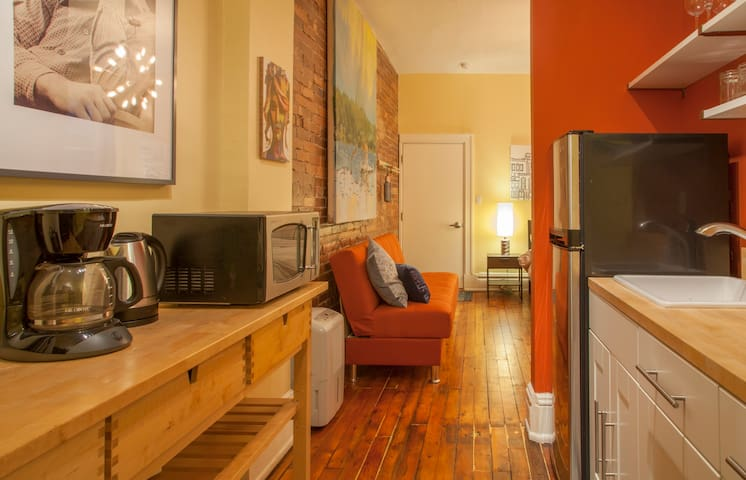 The apartment's footprint is small, but the tall ceilings give it an open feel.