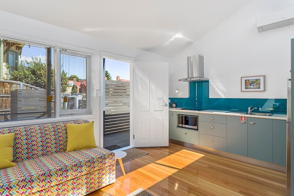 Bright and sunny outlook, beautiful floors and raked ceilings capped by skylight windows