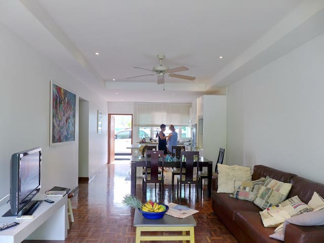 Spacious living area connected to open kitchen