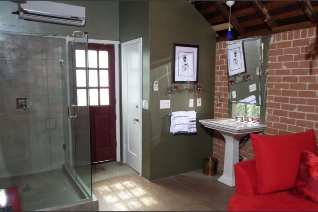 Built in rain shower for two and private loo