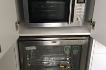 Amenities room has a microwave, sandwich maker, multi function air fryer/ cooker, Bbq with wok burner, fridge, kettle and Nespresso machine. Washer and dryer available for a fee. Ironing board and iron also housed here.
