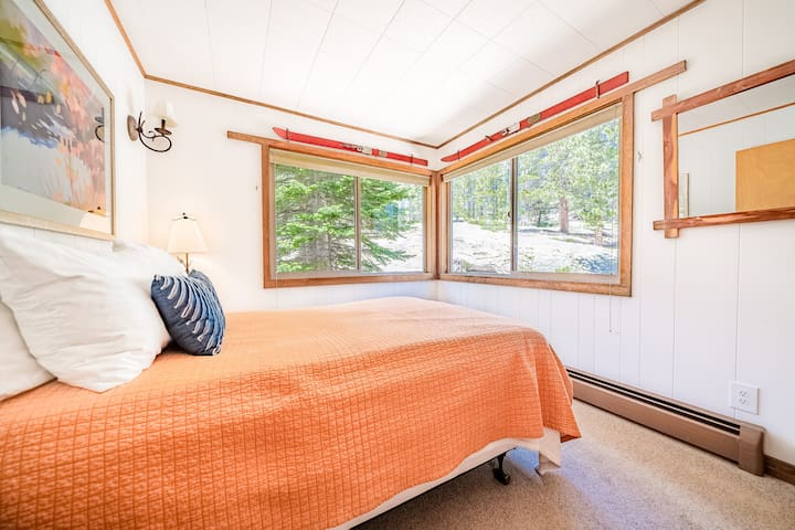 The first floor full bedroom offers incredible views into the forest on our ten secluded, private acres.