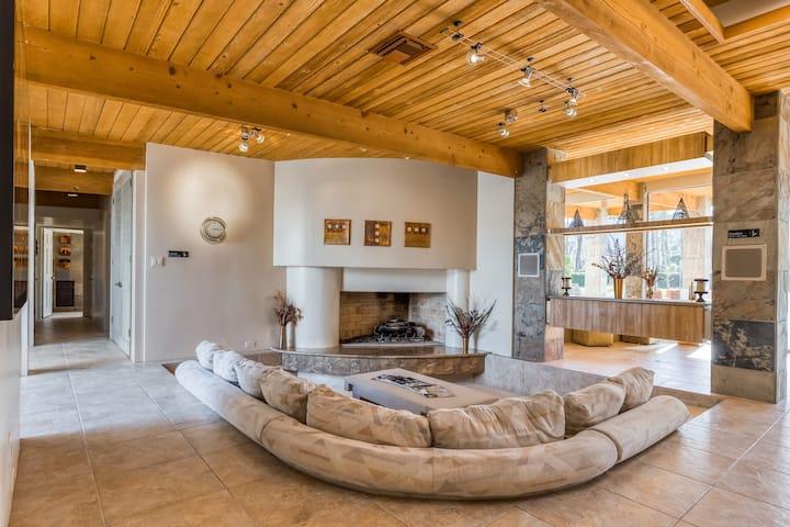 Luxurious home w/ expansive patio, open interior, gas fireplace, mountain views