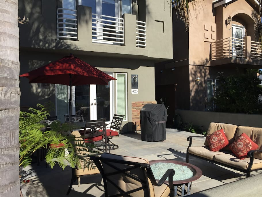 Step out through the french doors to a beautiful patio with BBQ and fire pit