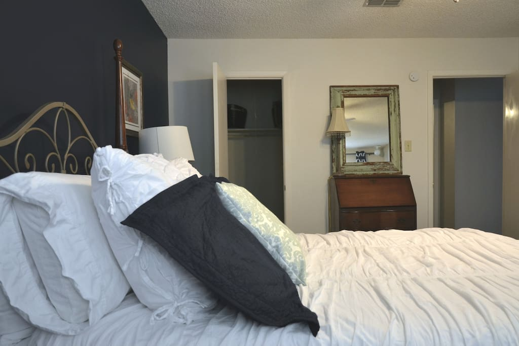 Lots of comfy pillows, pillow top mattress, walk in closet with shelves and hanging space.