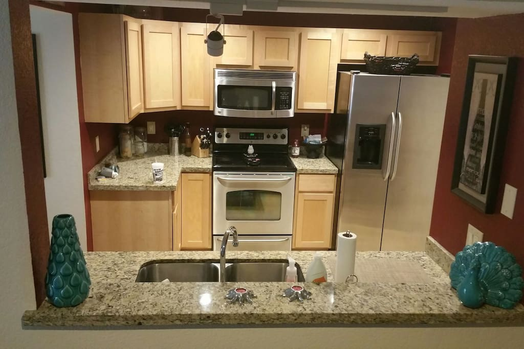 Kitchen with laundry room to the right