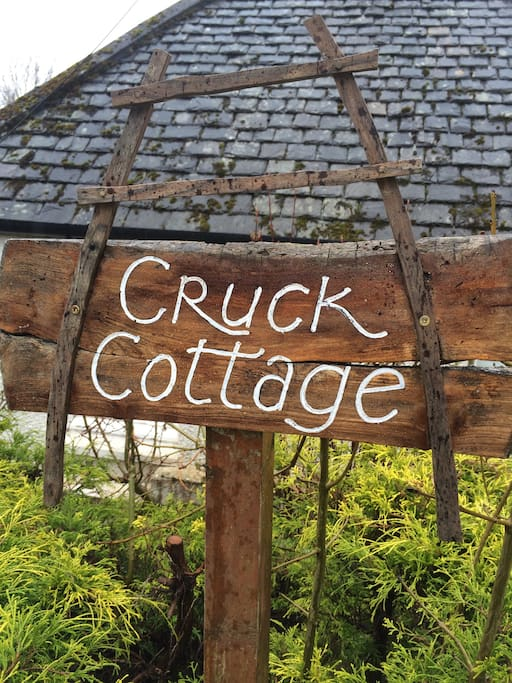 You will see this sign on the end of the house when you reach the cottage