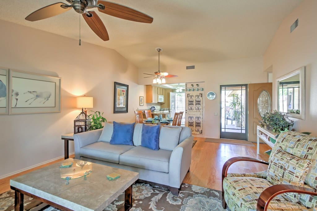 This charming home features oak wood flooring and homey furnishings.