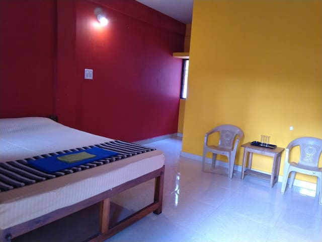 Deluxe AC Double Occupancy Room- Red & Yellow