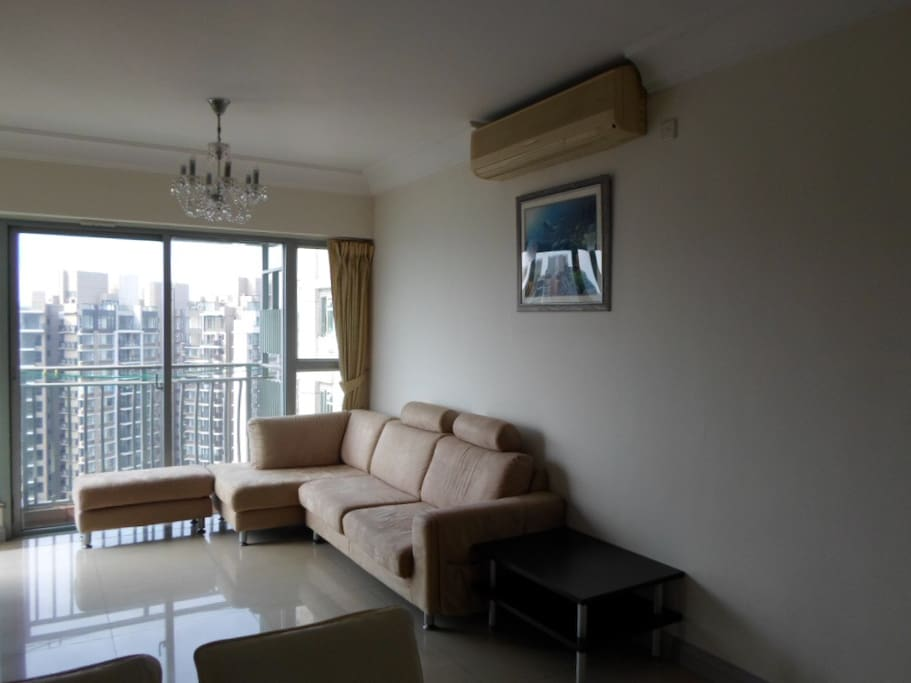 Brighter photo image of the sitting room provided with 2 HP split-type air conditioner.