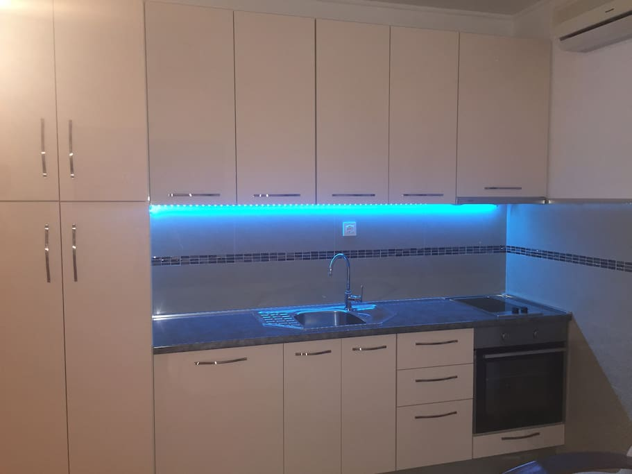 New and modern kitchen, including but not limited to: owen, fridge, water kettle, kitchenware, wine glasses... There is a closet for you to put your clothes in. Romantic LED lights are available as well.