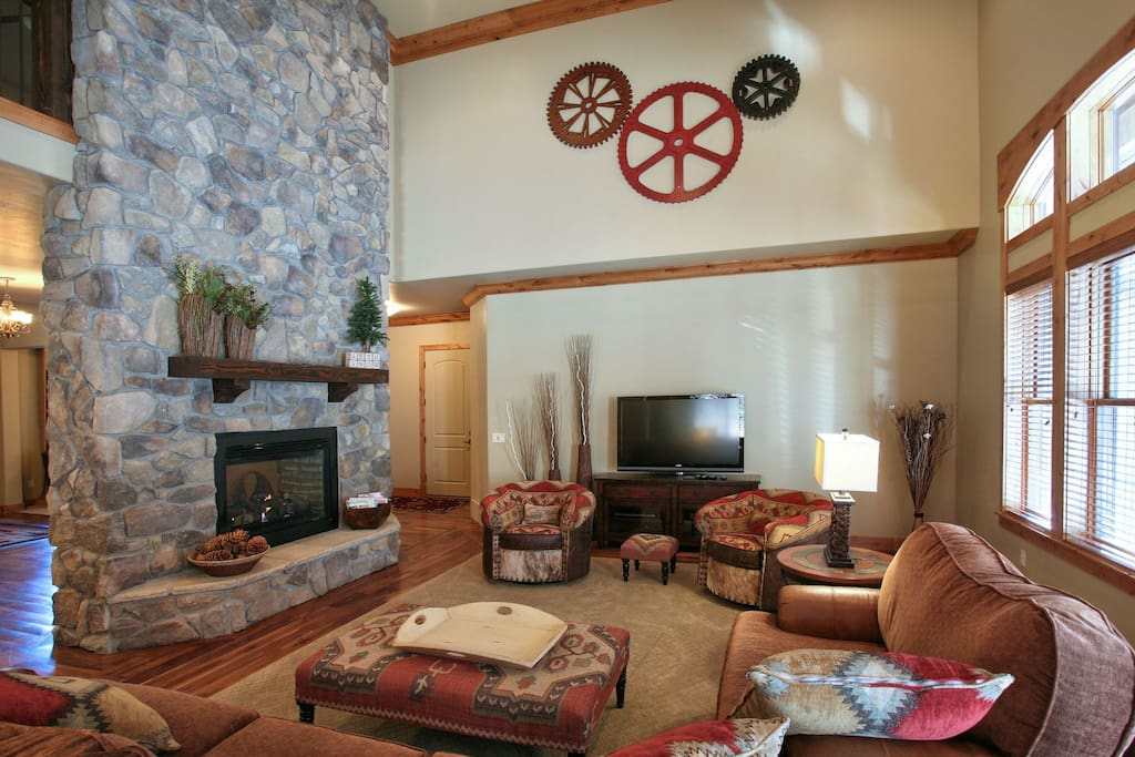 Double sided gas fireplace off the kitchen and great room for all to enjoy.