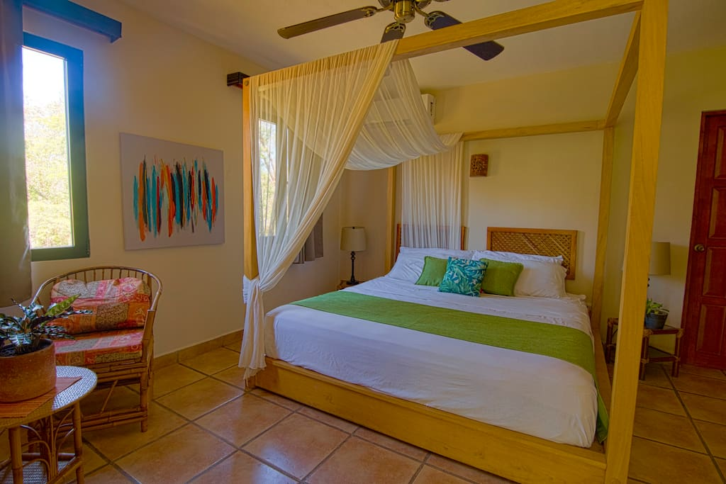 Room with King size bed, closed bathroom, AC, Cable, Safe, Closet and view on the pool