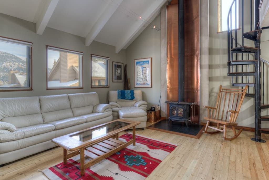 Main living area- wood burning stove- deck over looking Yellow mountain
