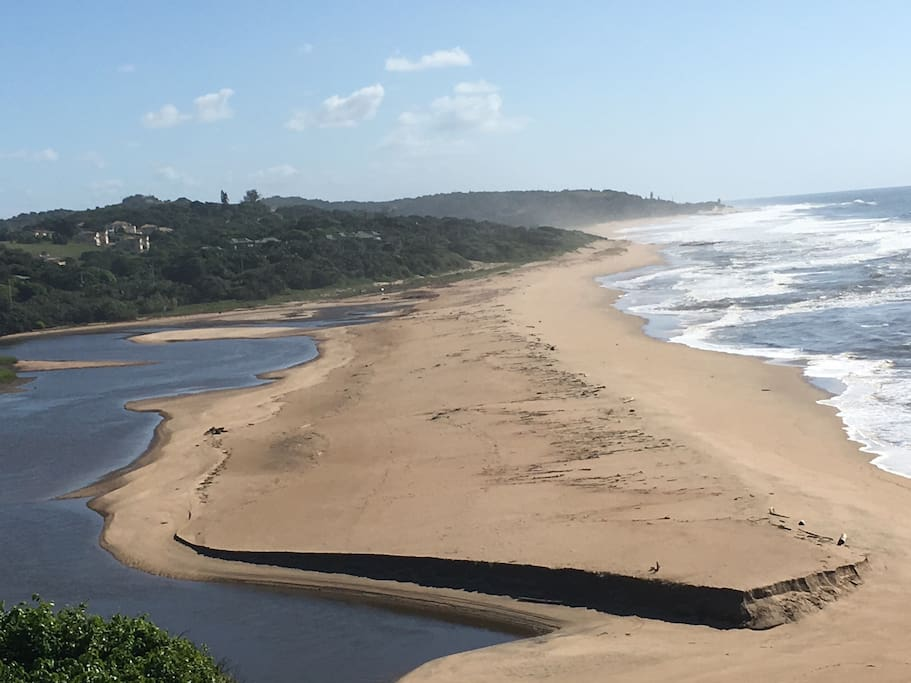 The unit is on a hill which has these beautiful views of the Mtwalume river and the beach  where an estuary is formed