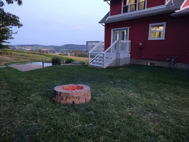 Spend the evening, relaxing by the fire pit, just off the deck in the backyard
