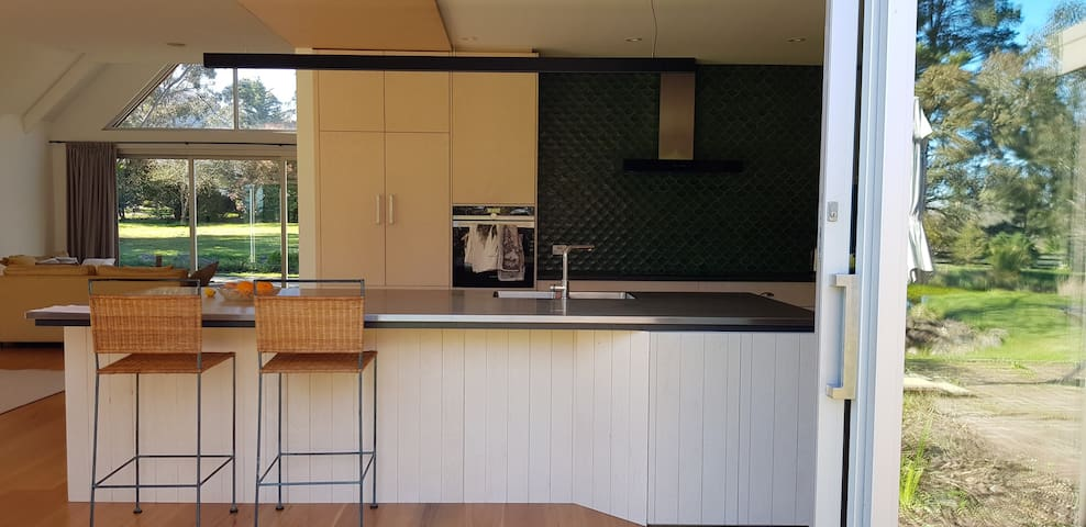 Sliding doors open out from the kitchen straight into the garden.