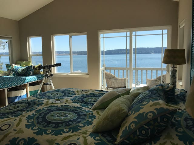 Upstairs bedroom view- with daybed and balcony. Indoor outdoor seating area.