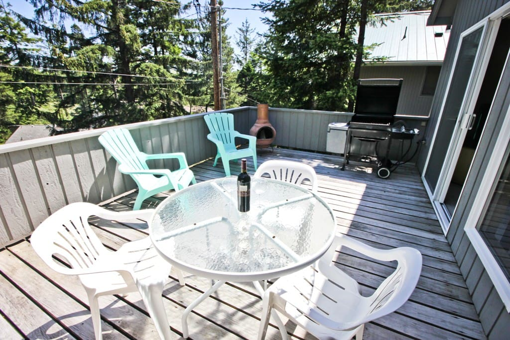 Upper deck with a patio table/chairs, gas BBQ and portable outdoor fireplace