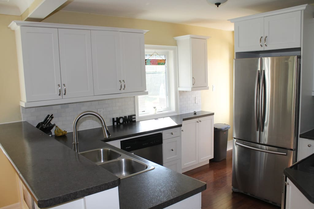 The kitchen is bright and has stainless steel appliances. The cupboards all filled with all the dishes and cooking pots and pans you need to prepare your meals.  We provide essentials like oil, spices, coffee, tea, etc.