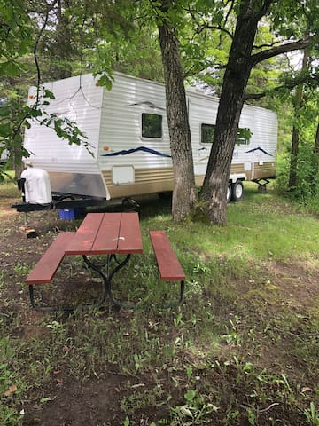 Camper on the Rainy River at Camp of the Woods