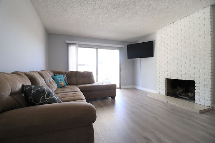 Shared living space, with large sofa,  Spectrum Cable, Netflix and access to the backyard
