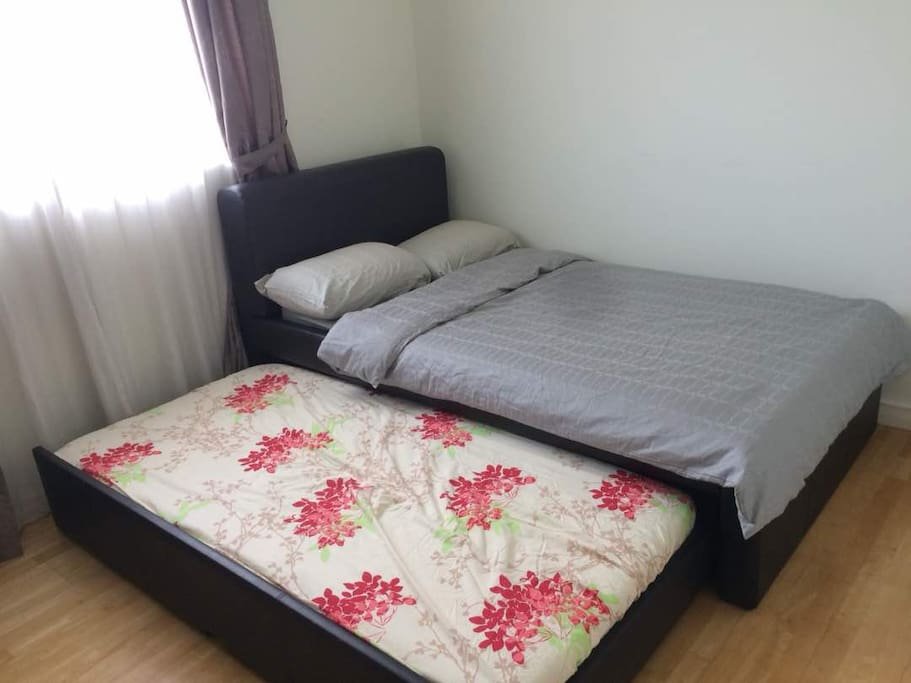 Super Single bed with single mattress below.