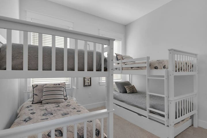 3rd bedroom with two bunk beds and one pull out twin bed and smart TV
