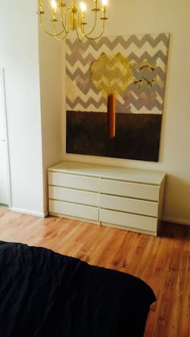 Bedroom 1, art and place to store