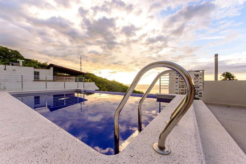 Infinity pool and sun deck with amazing views of Banderas Bay, El Centro, Zona Romantica, Marina Vallarta, and Zona Hotelra