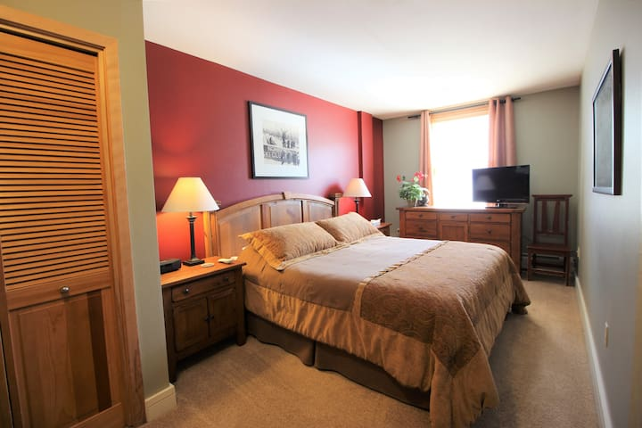 Sleep Number king master with end tables, lamps, dresser and flat screen TV with HD cable.
