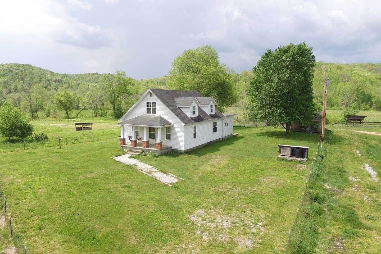 4 BR 1 BA whole house farm stay with fenced 1/3 acre yard.