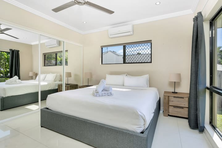 The light-filled first bedroom is fitted with a double bed and has a large mirrored wardrobe for storing your belongings.