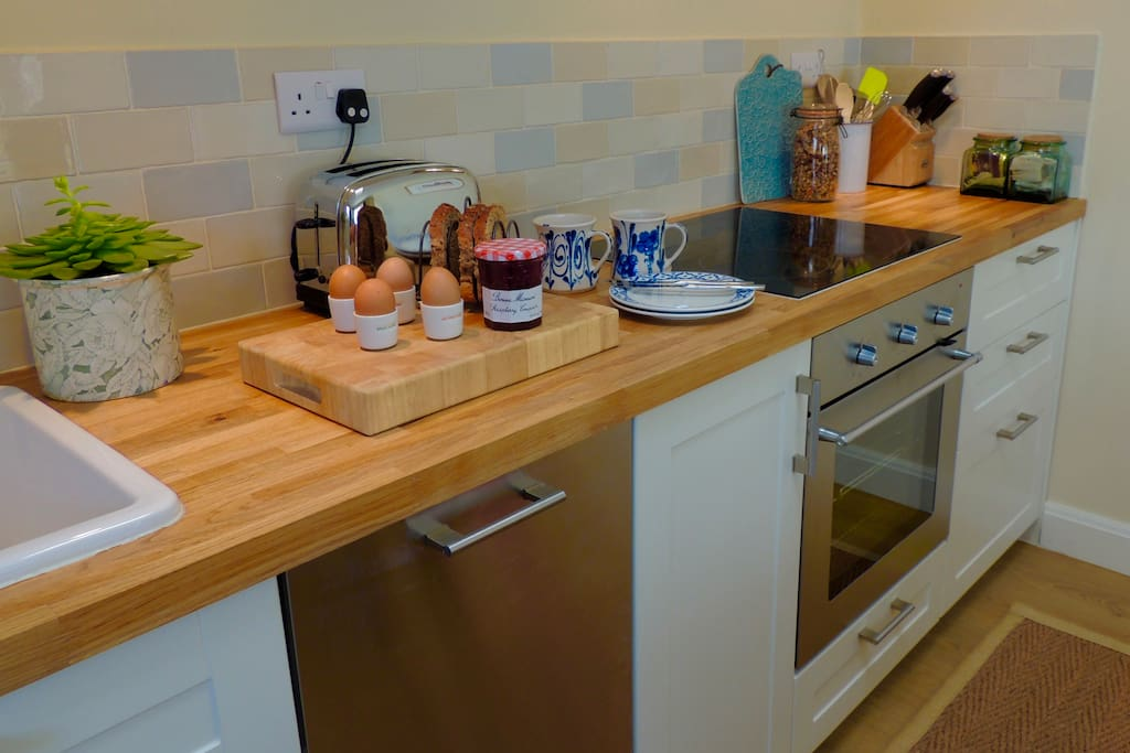 A fully equipped newly fitted kitchen with full sized dishwasher and electric oven with hob over.