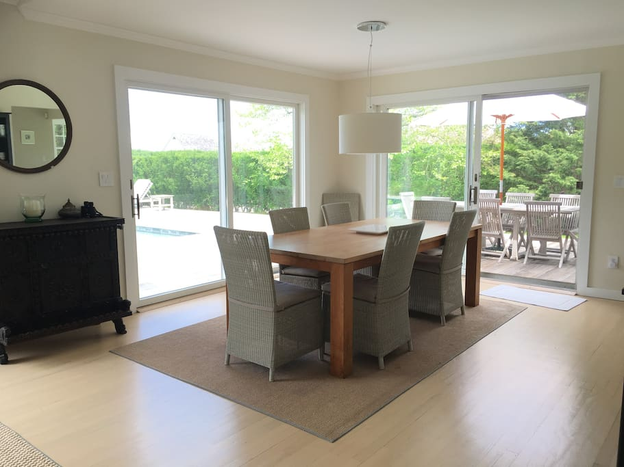 Dining room with views of pool deck and lawn