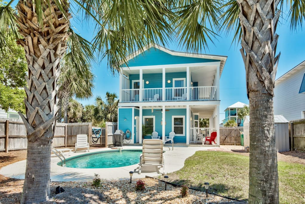 Rear View of Home With Private Pool & Privacy Fence
