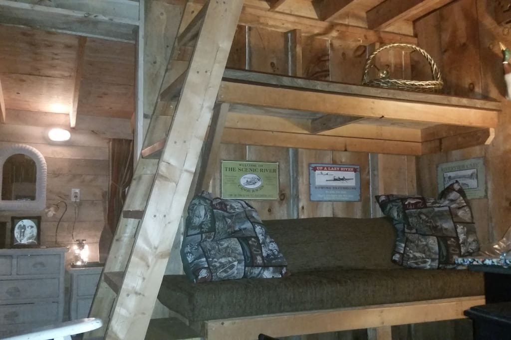 A sitting area bunk is undersized but perfect for naps. A television with internet set- up is in the sitting area. For the limber, a ladder leads to the loft and to one double bed.
