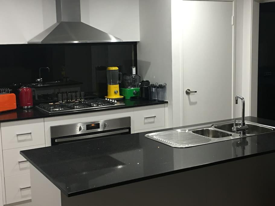 A fresh modern clean kitchen with appliances