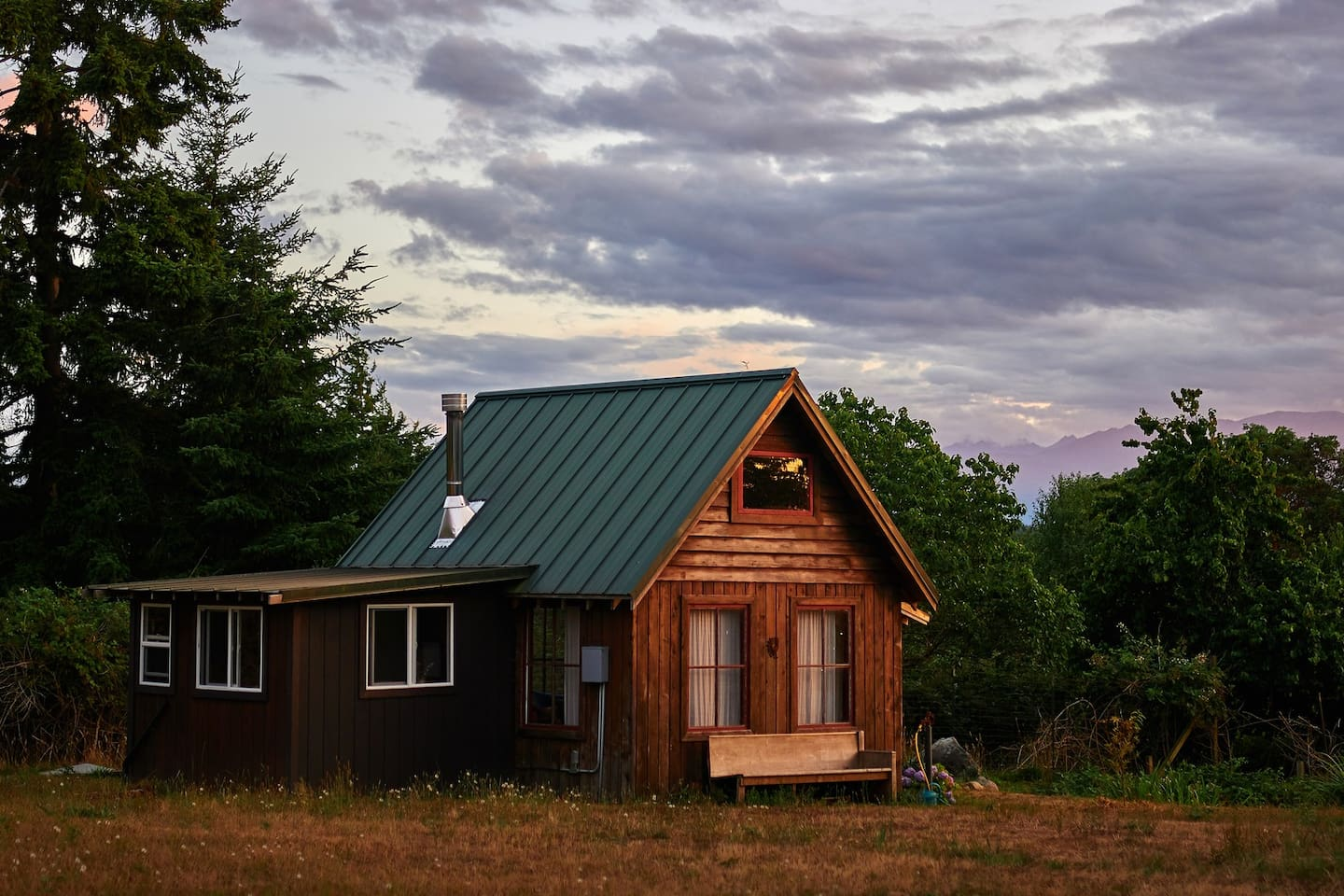 """Singing Frog, at Plum Nelli, is a little cabin overlooking a frog """"pond"""" and a bit further, Kilisut Harbor."""
