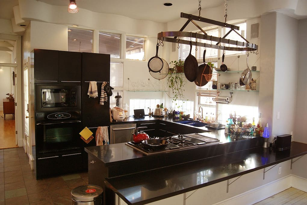 The main kitchen is fully stocked and has plenty of space to get cooking!