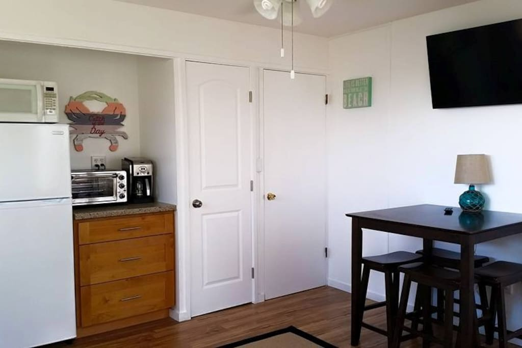 Dining area has seating for 4 and large flat screen TV